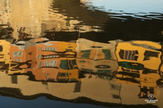Reflections of Ponte Vecchio in the Arno River, Florence, Italy
