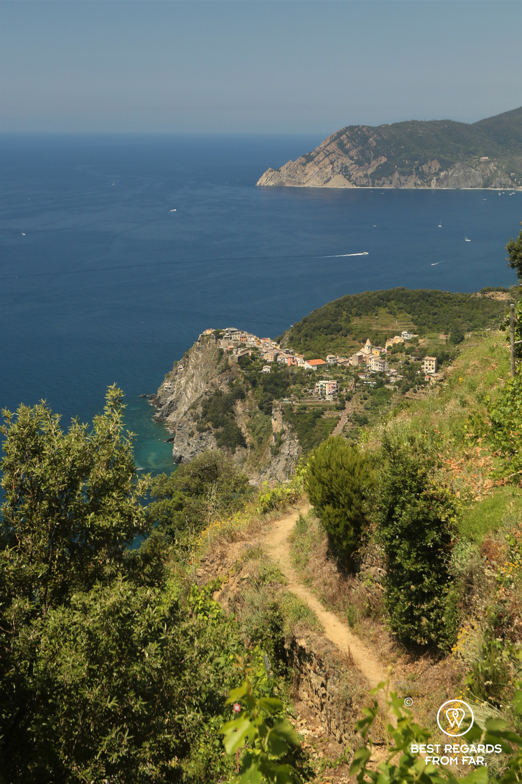 Hiking path leading to a small village along the seaside in Italy