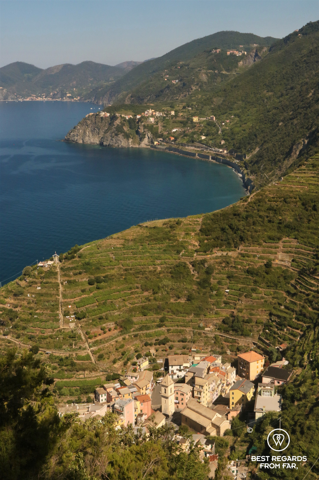 Stunning view on the sea, the amphitheater of terraced vineyards and the city of Manerola in Cinque Terre, Italy