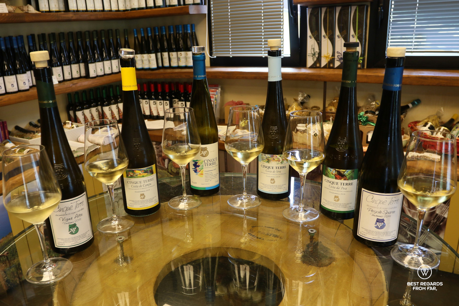 Six bottles of Cinque Terre white wines with six glasses of white wine
