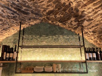 Old wine cellar with wine glasses and bottles