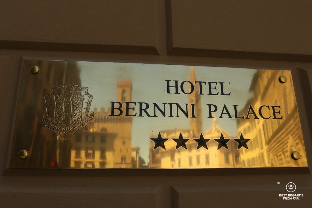 Golden plate of hte Hotel Bernini Palace reflecting the Palazzo Vecchio and the Duomo, Florence, Italy.