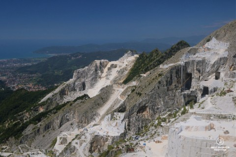 Blue skies and white marble quarries of Carrara