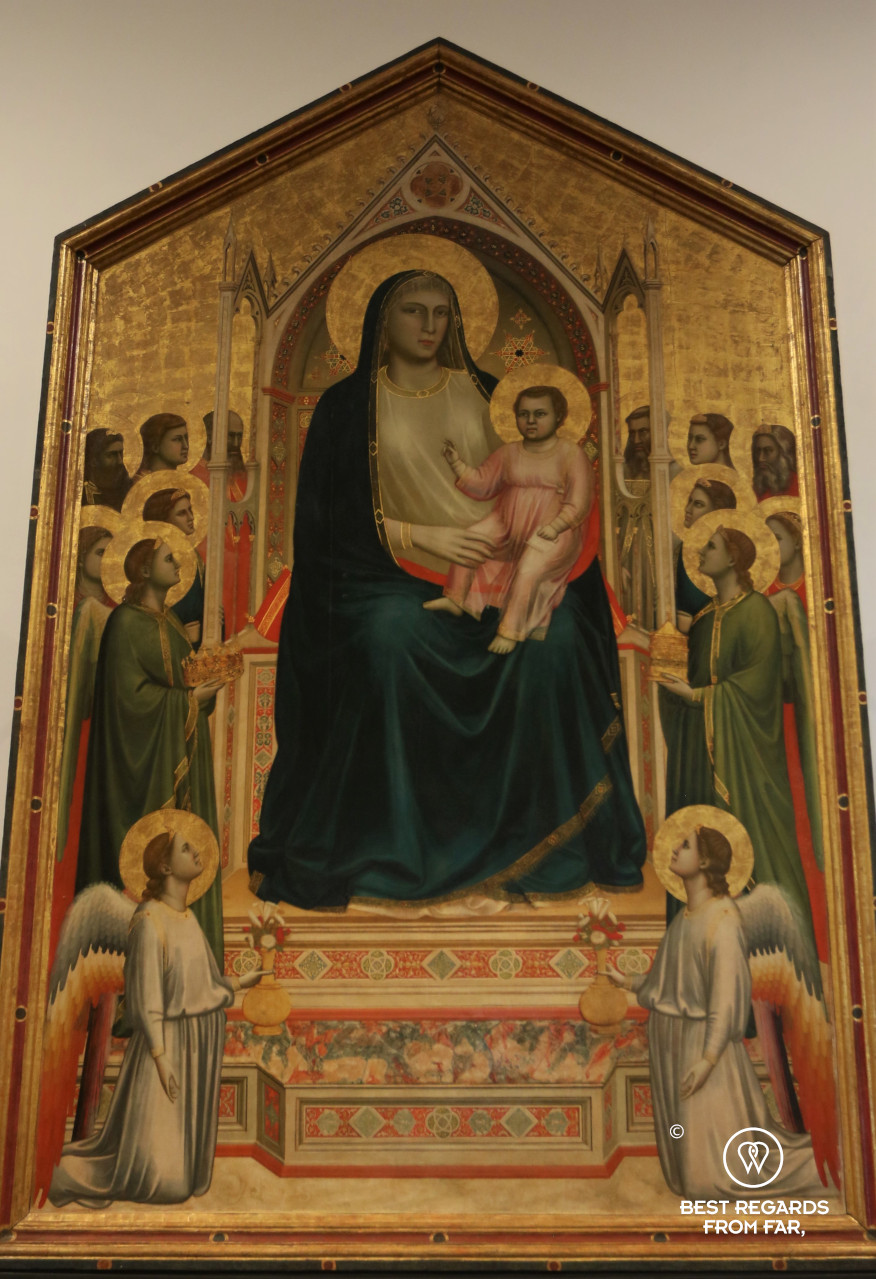 The Madonna and Child Enthroned with Angels and Saints by Giotto in the Uffizi museum in Florence, Italy