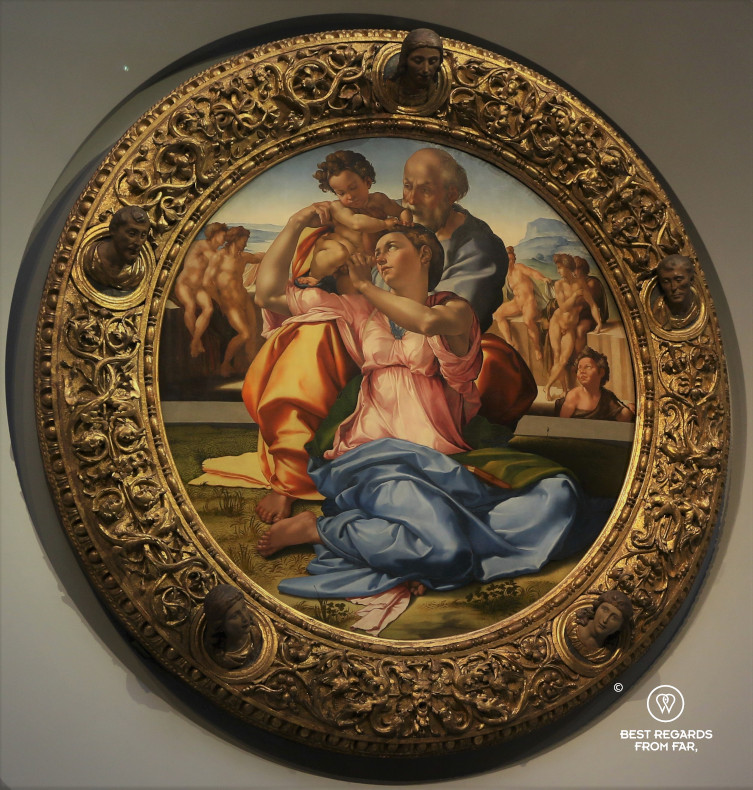 The Holy Family with the Young St. John the Baptist by Michelangelo in the Uffizi museum in Florence, Italy