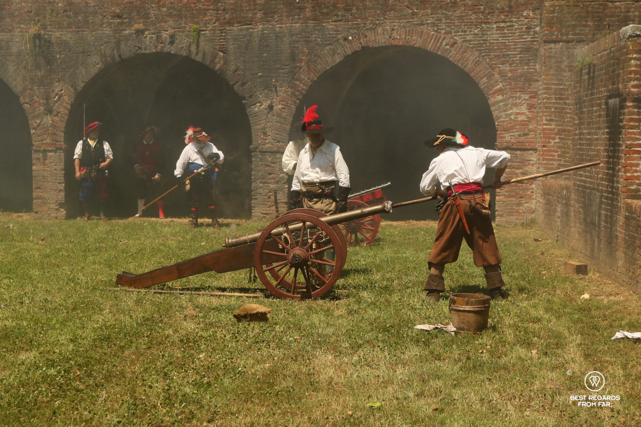 Men in period costumes firing the canons for the Saint Paolino celebrations in Lucca, Italy.