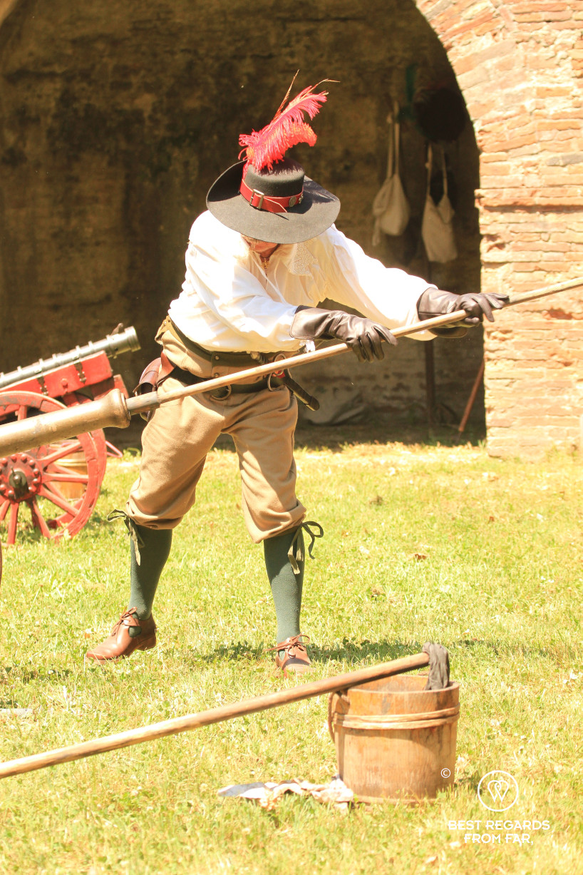 Man in period costumes firing the canons for the Saint Paolino celebrations in Lucca, Italy.