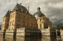 Castle of Vaux-le-Vicomte and its moat in the summer evening sun.