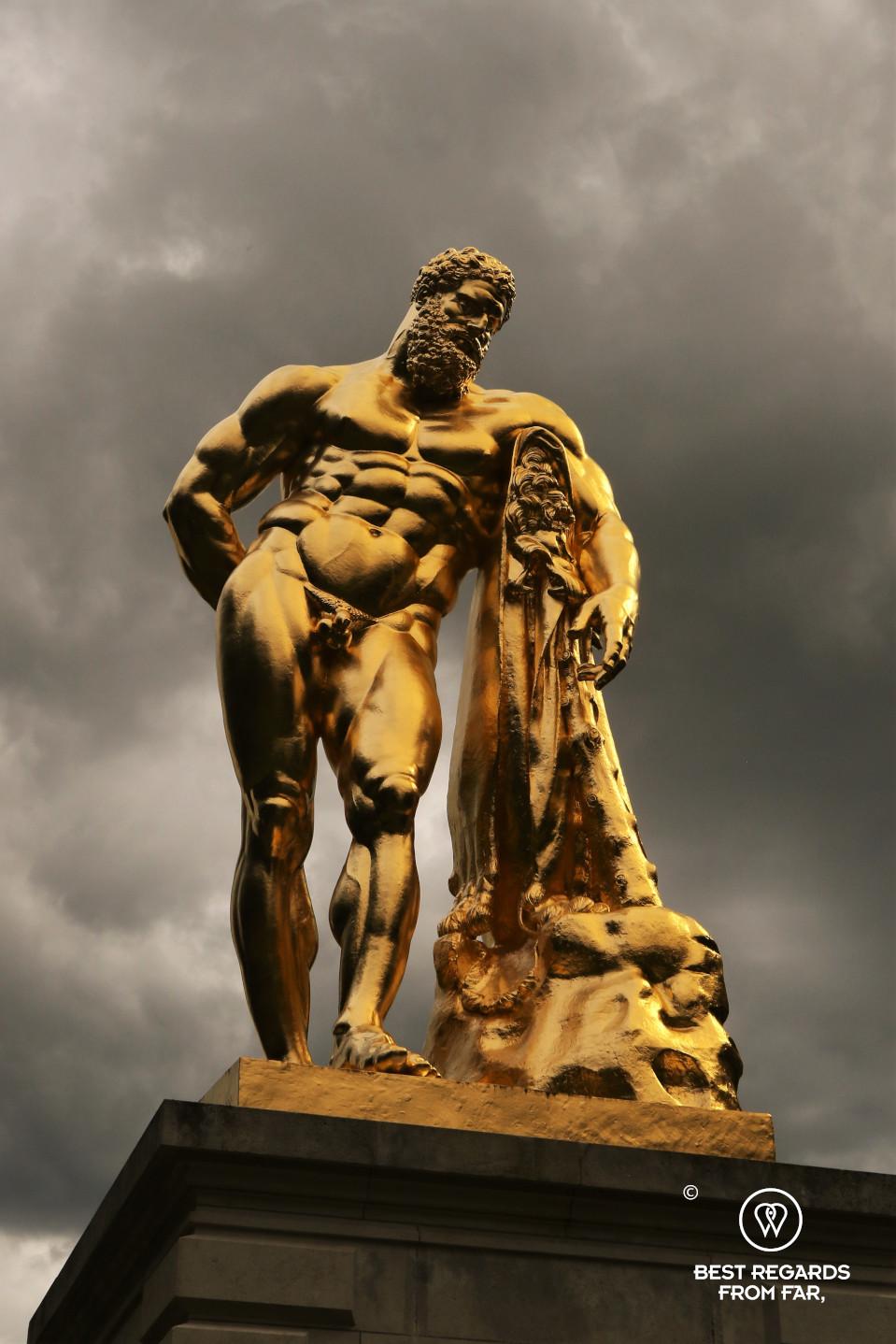 The golden sculpture of Hercule in the garden of the castle of Vaux le Vicomte, France.
