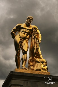 The golden sculpture of Hercule in the garden of the castle of Vaux le Vicomte, France.
