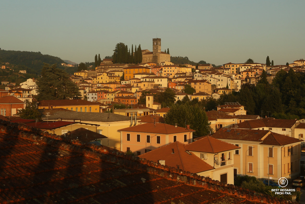Barga dominated by its Duomo at sunset, Italy.