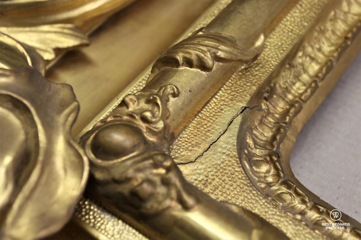The crafts of Florence: restoring golden frames.