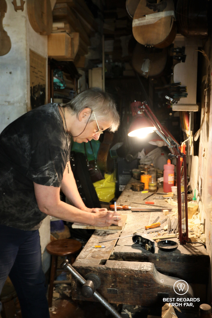 The crafts of Florence: Jamie Lazzara making a violin in her workshop.