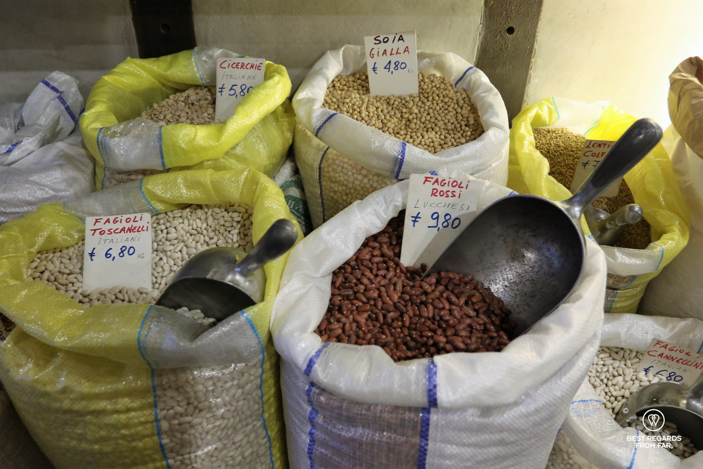 Large bags of beans in a store in Lucca