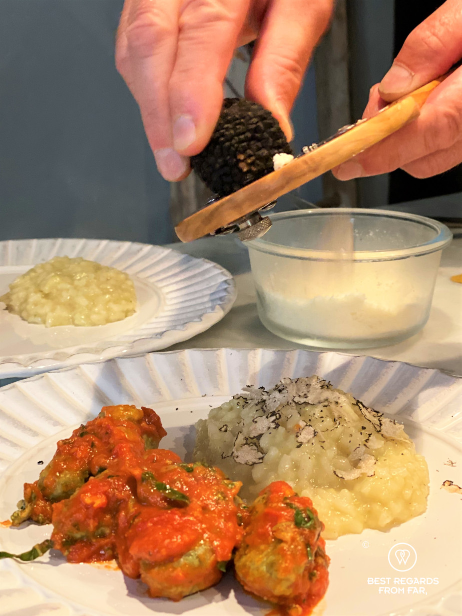 White plates with gnudis and a truffle risotto