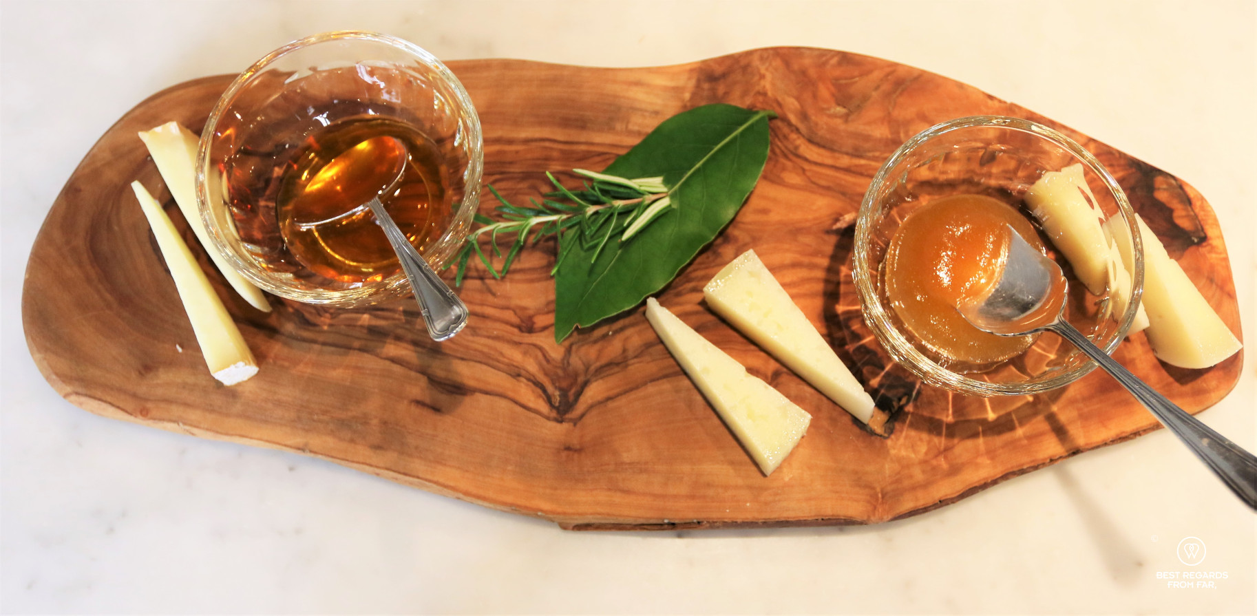 Three types of Italian Pecorino cheese served on a wooden board with honey and mustard