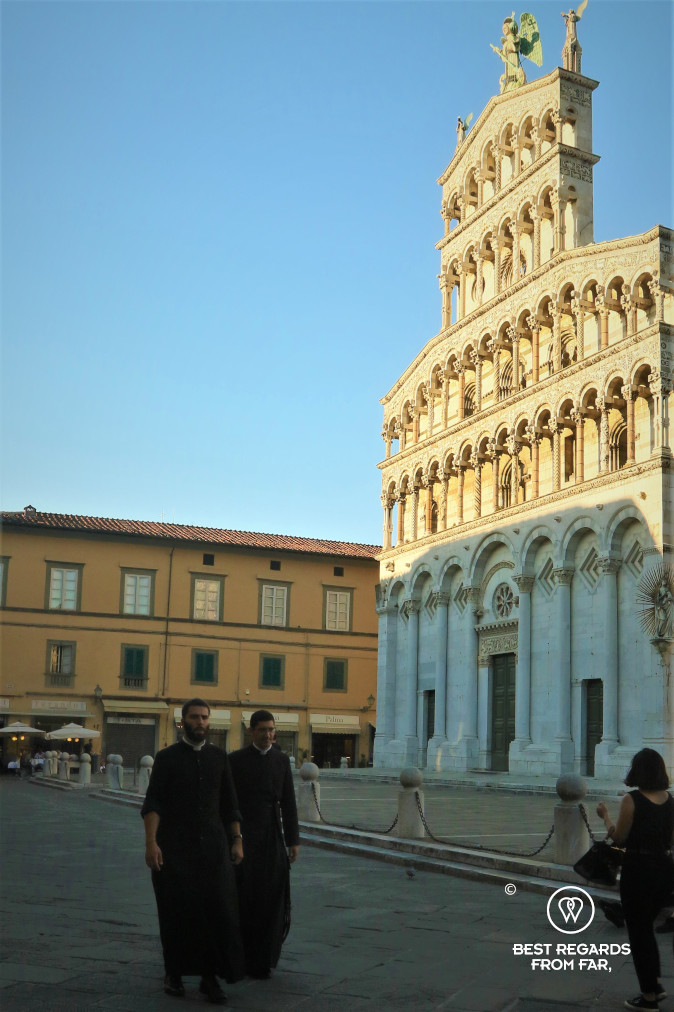 Priests in front of the Saint Michael church in Lucca, Italy