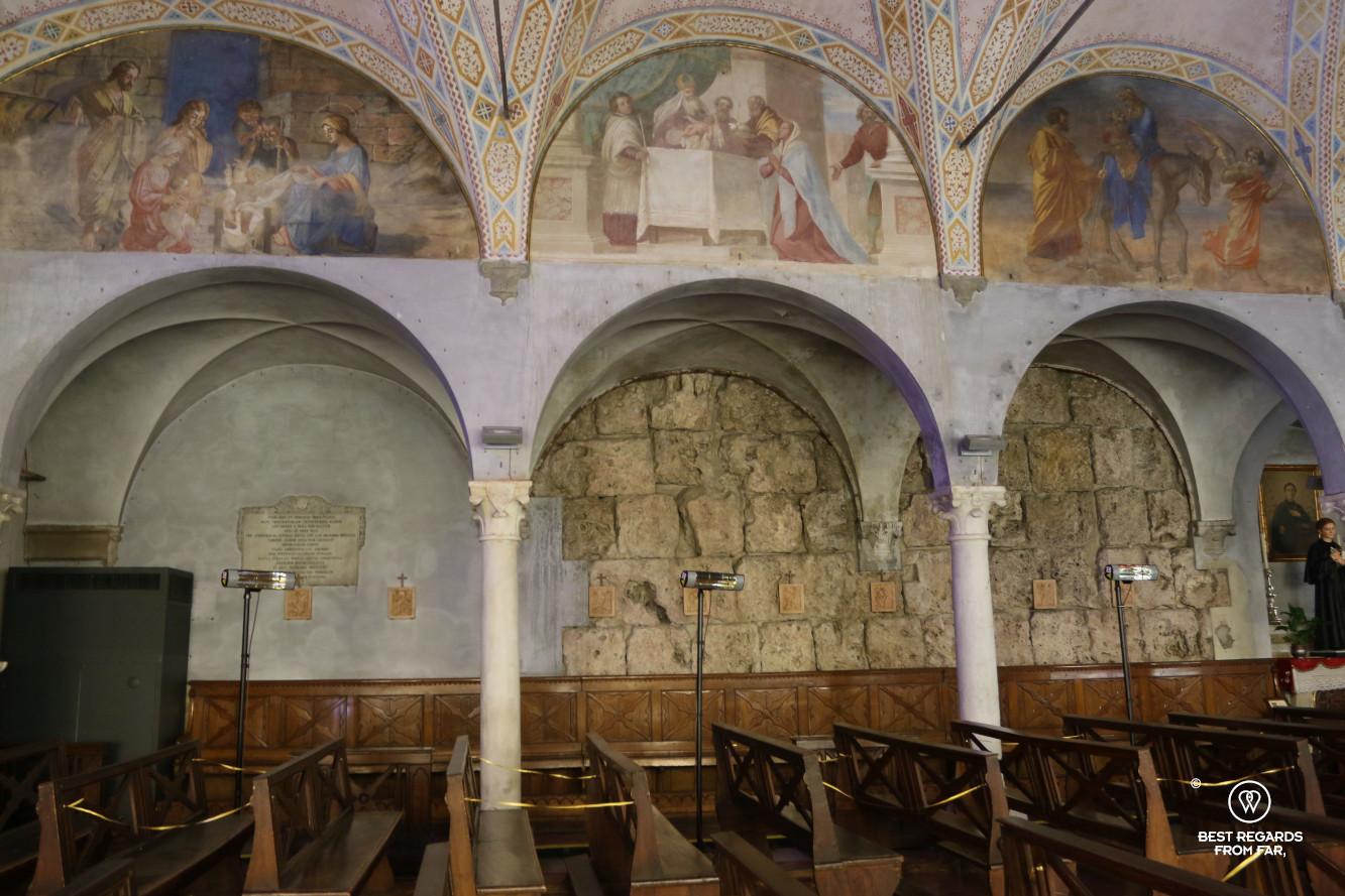 The roman wall in the Santa Maria della Rosa Church, Lucca, Italy