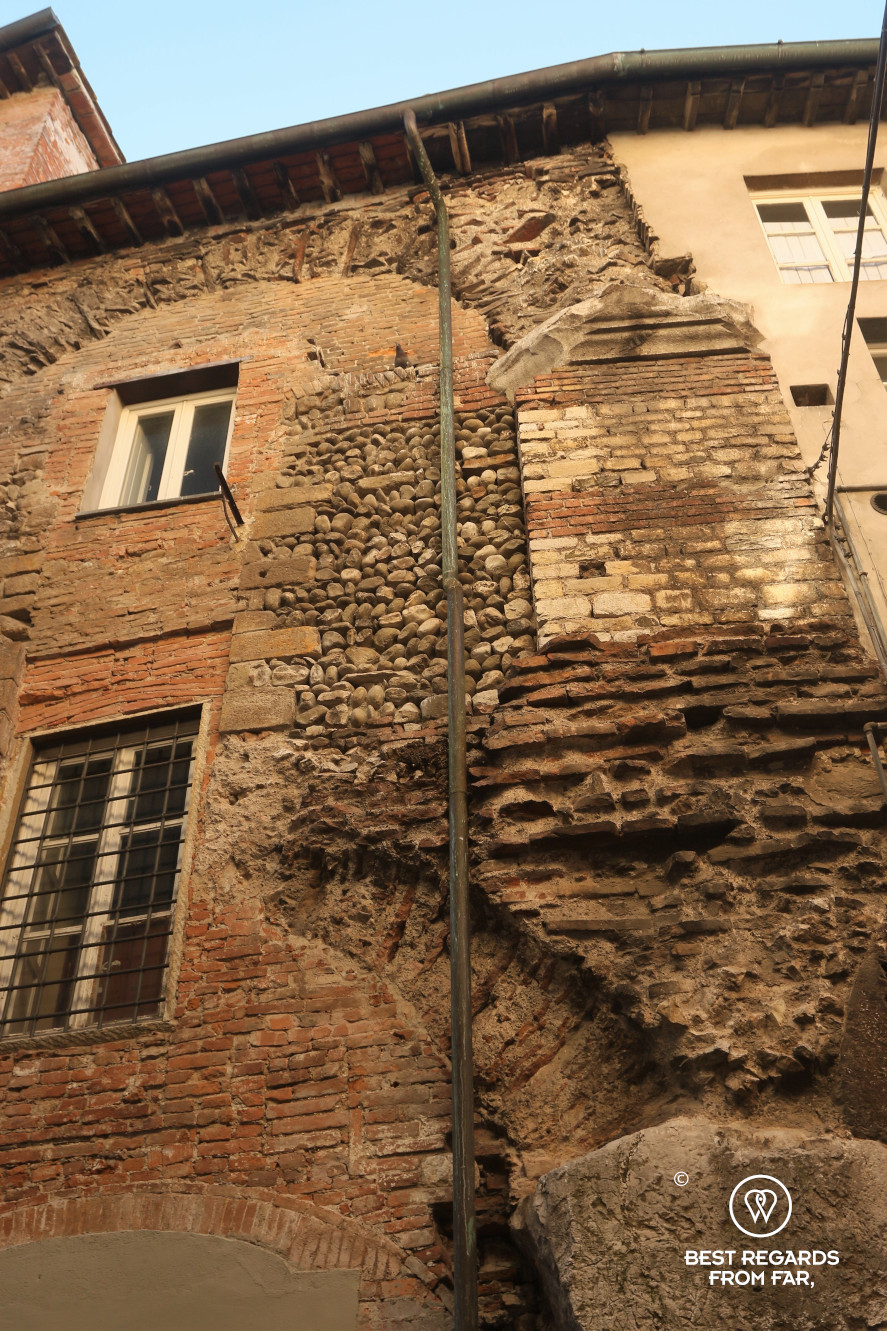 Old stones of a house in Lucca, Italy