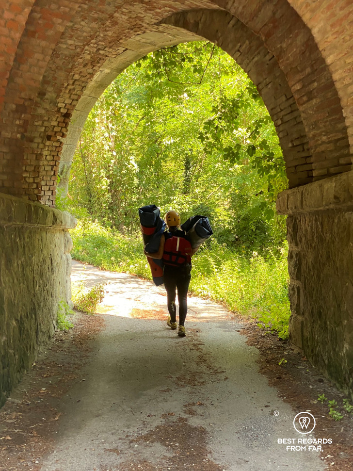 Simply walking out after pack rafting around bagni di Lucca, Tuscany, Italy.