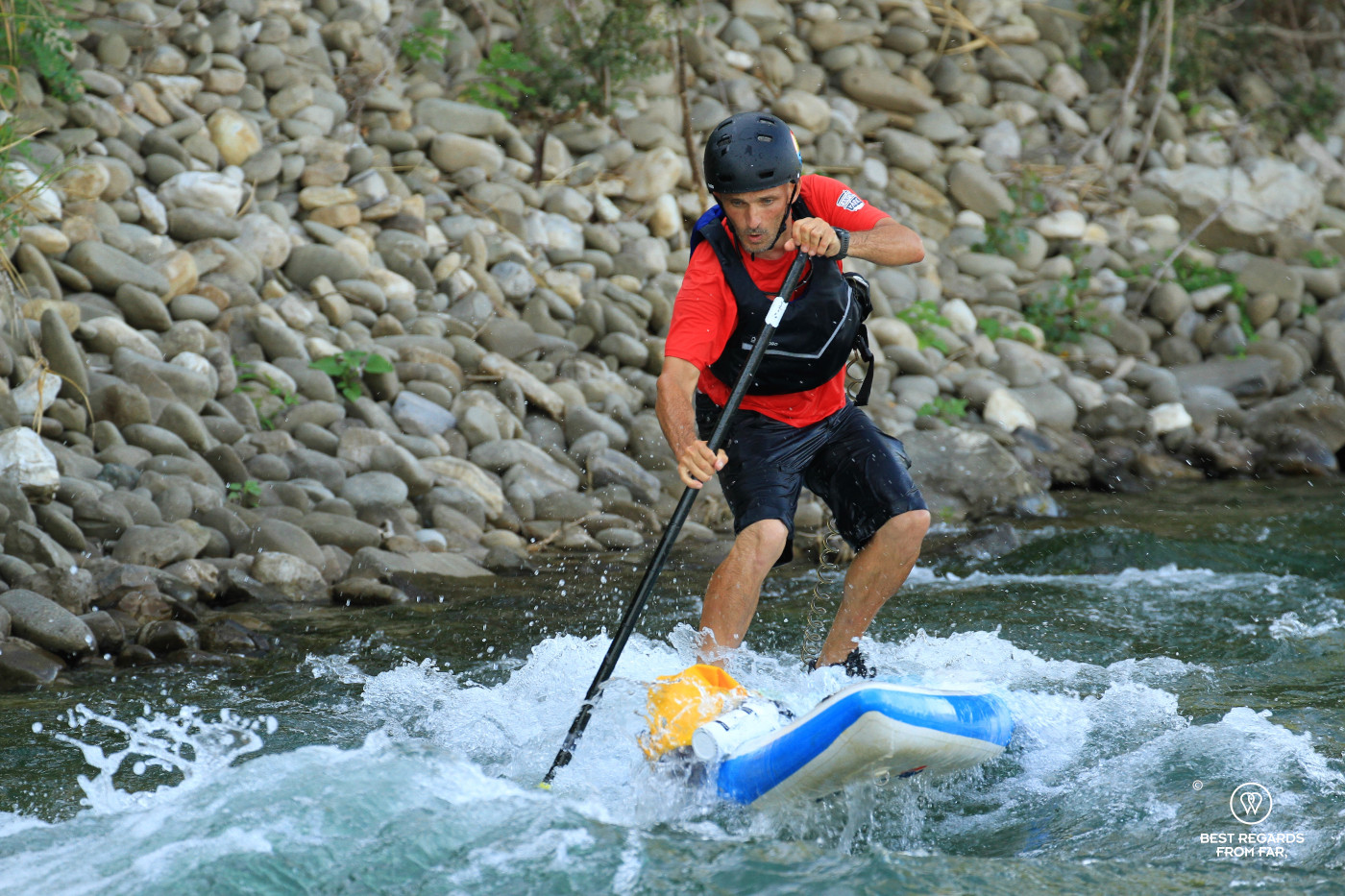 Stand Up Paddling the white waters of the Serchio River by Lucca, Italy.