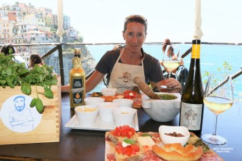 Tasting the pesto with bites and local wine after the pesto workshop at Nessun Dorma with a stunning view on the village of Manarola, Cinque Terre, Italy