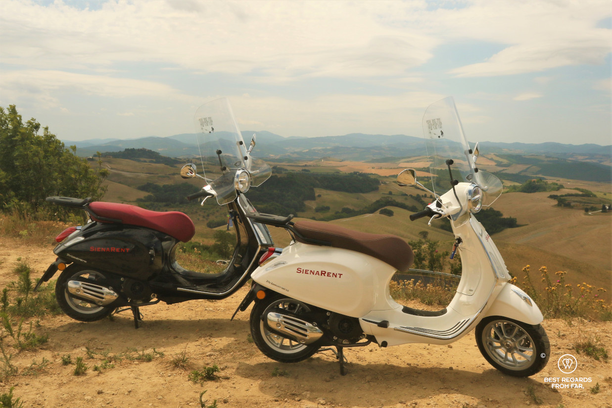 Two Vespa scooters overlooking the Tuscan landscape, Italy