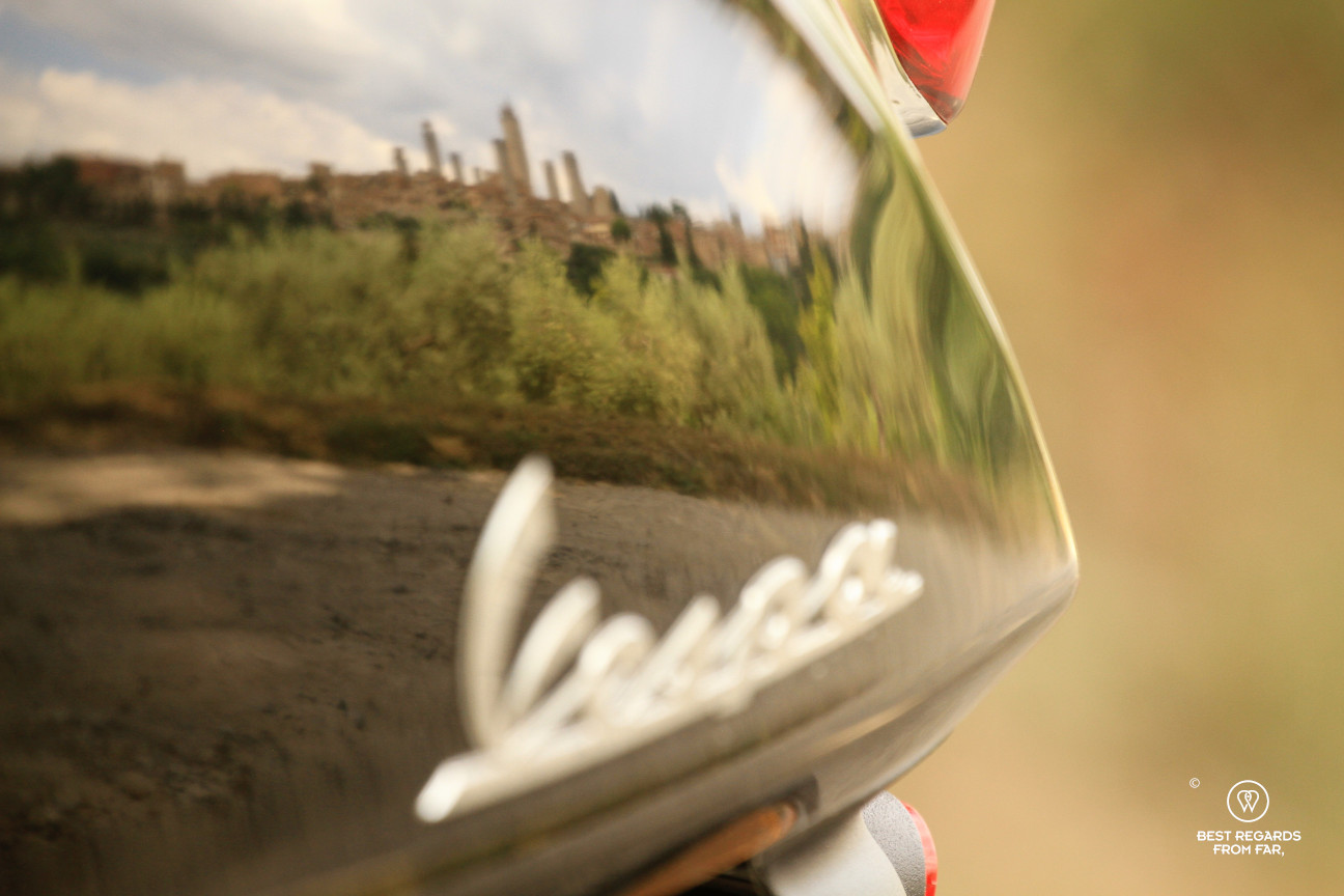 Reflection of the towers of San Gimignano on a Vespa scooter, Tuscany, Italy