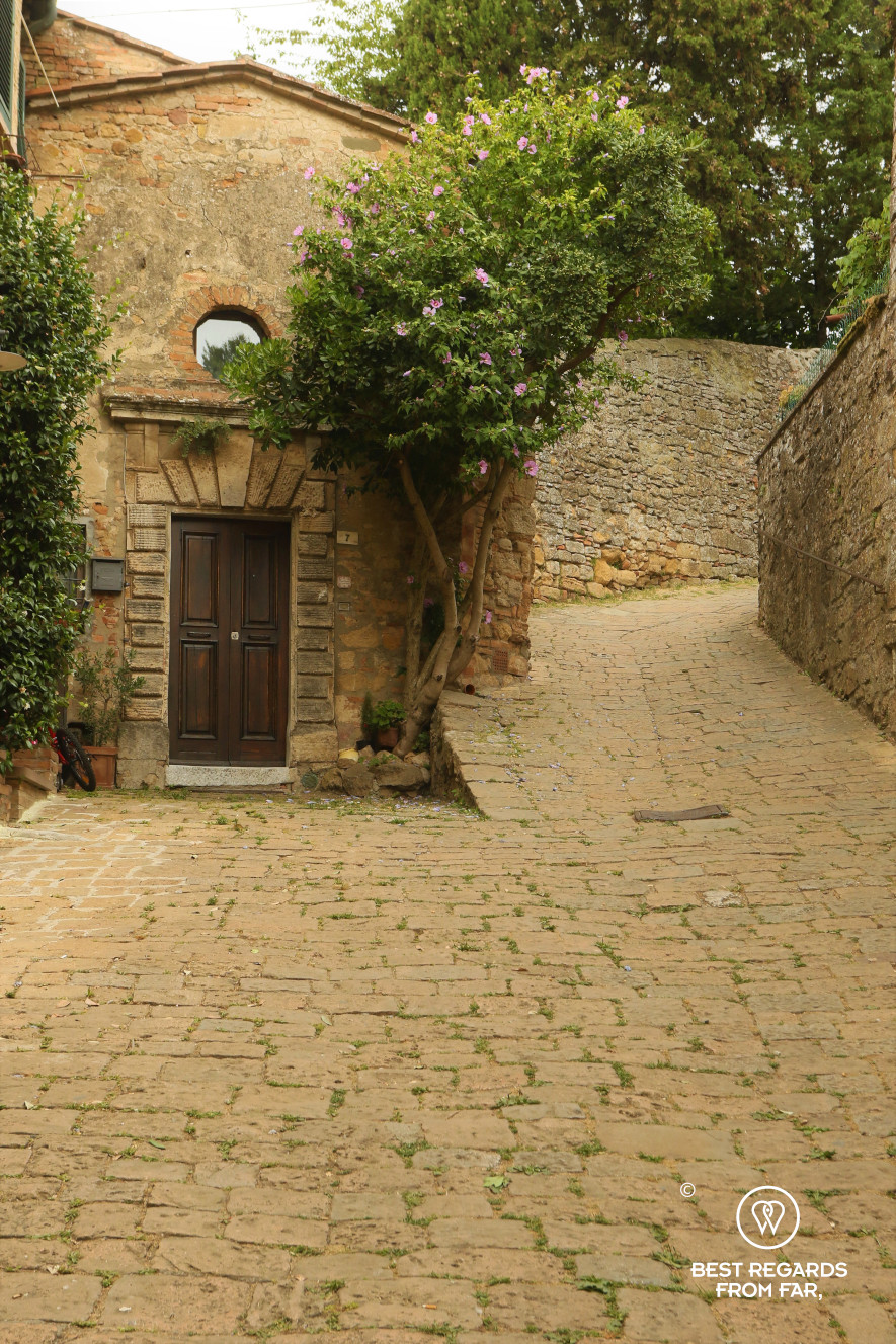 A street in Volterra with cobblestones, Tuscany, Italy