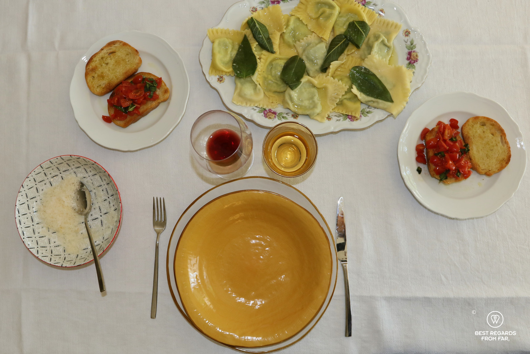 Fresh ravioli with sage sauce, bruschetta and a plate