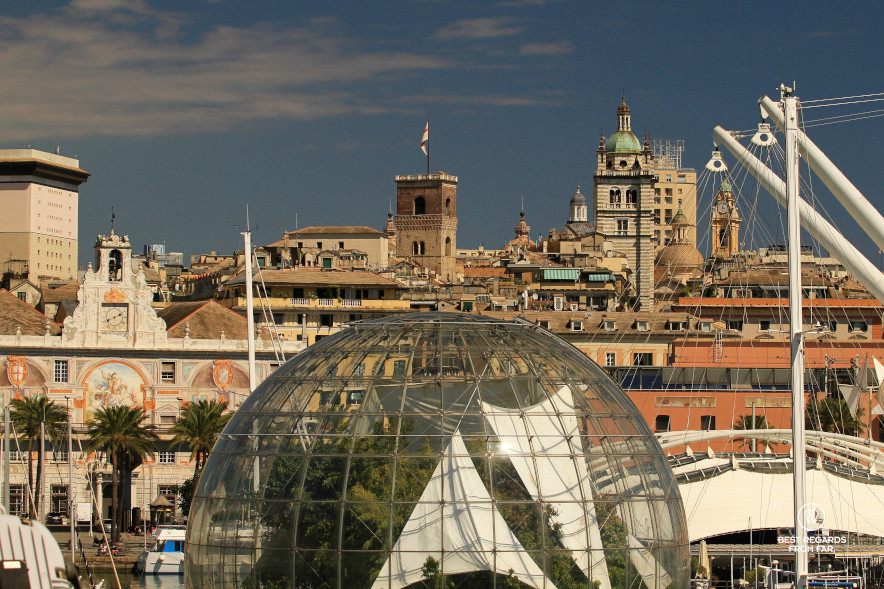 Renzo Piano's Biosphere contrasting with the medieval towers in Genoa, Italy