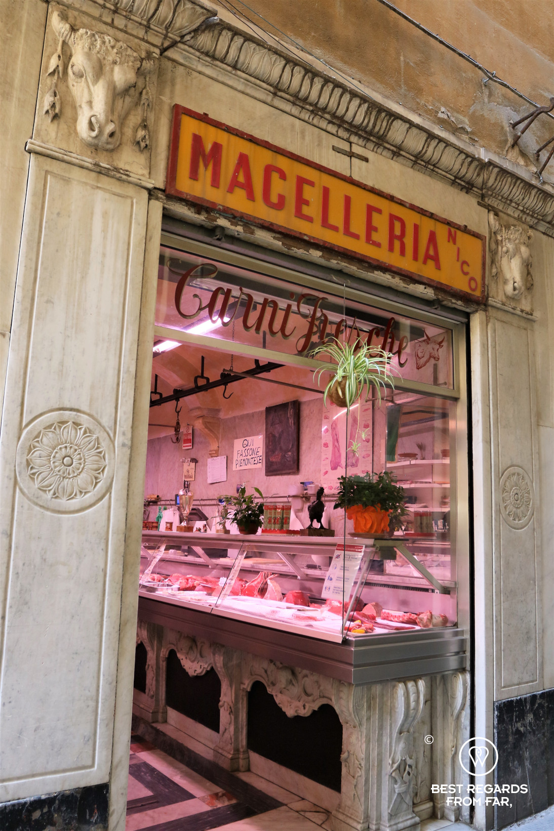 Scultpted facade of a butcher store in Genoa, Italy