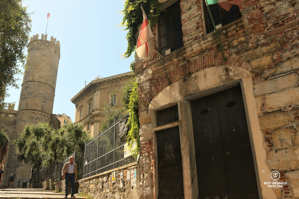 Chirstopher Columbus' birth house with a medieval tower at the background in Genoa
