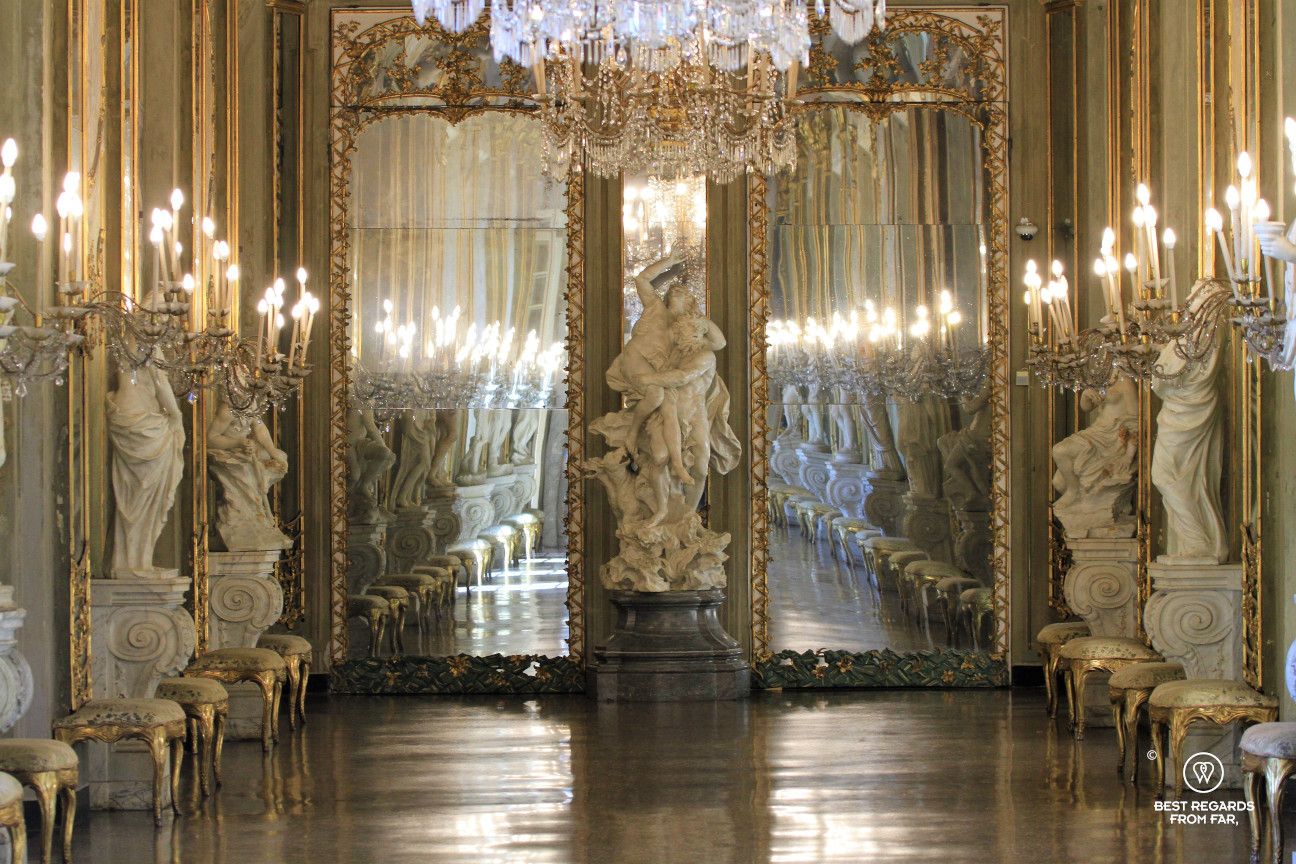 Room with sculptures, lamps and mirrors in Italy