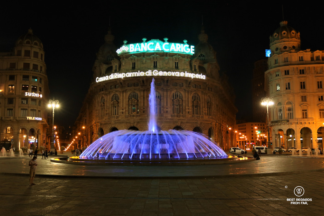 The lit up fountain at Piazza de Ferrari at night, Genoa