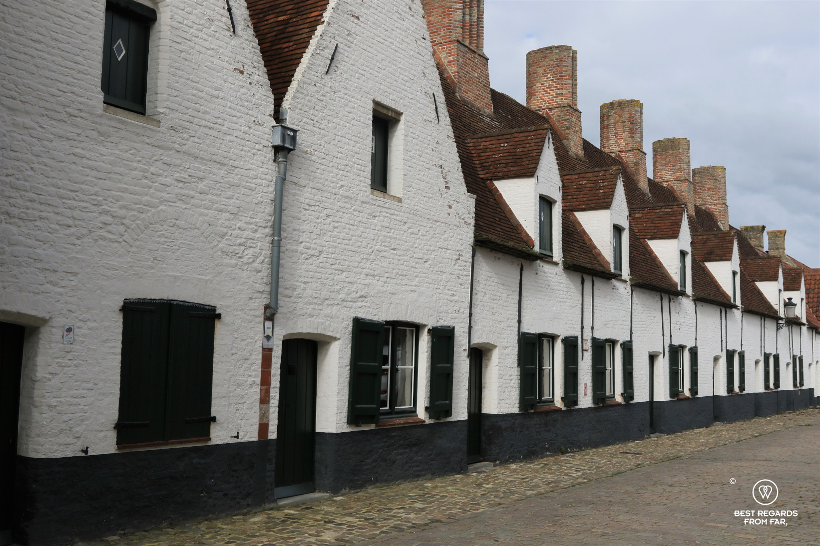The typical white alms-houses in Bruges, Belgium