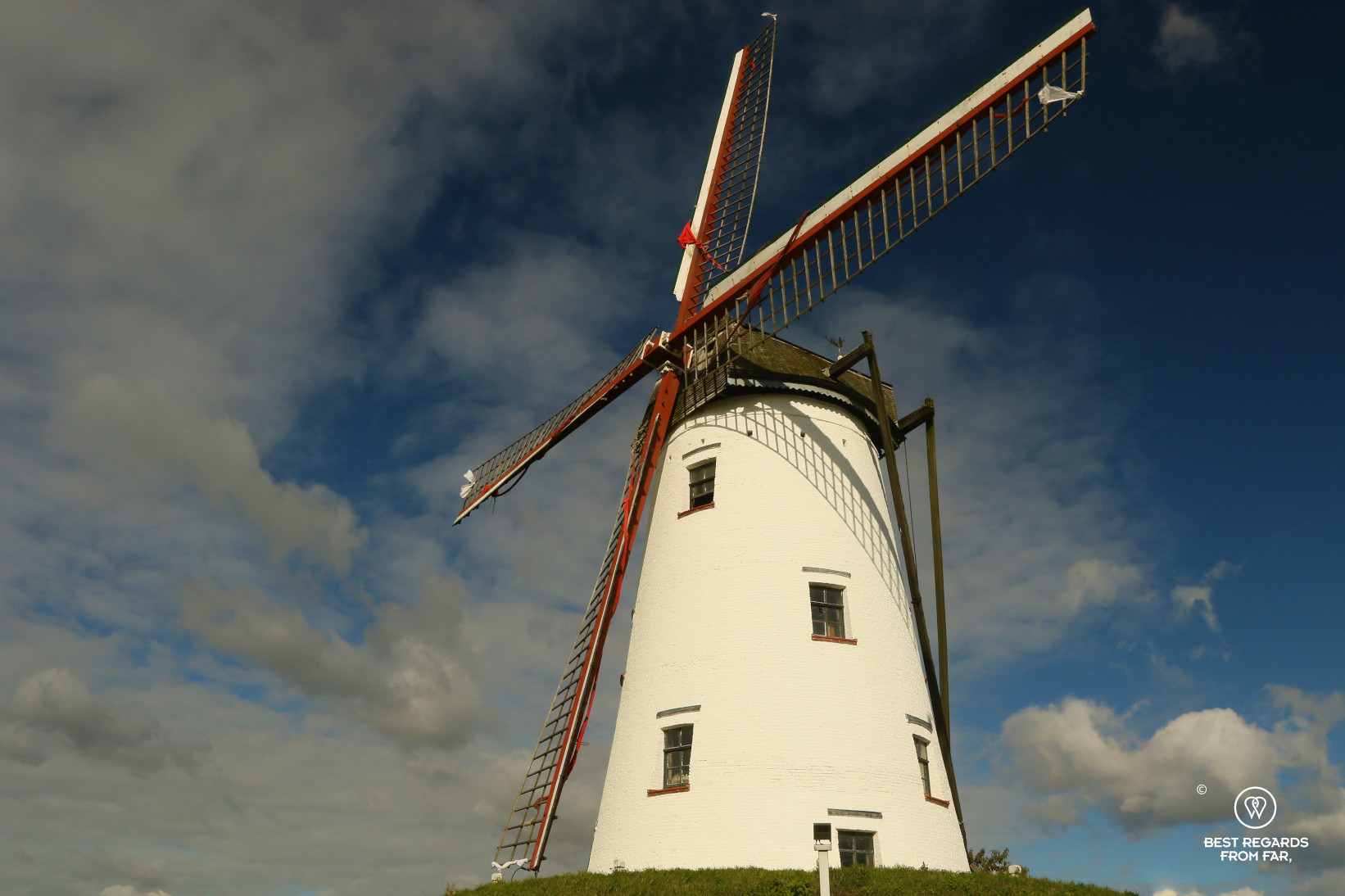 Biking from Bruges to Damme and passing by a traditional windmill, Belgium