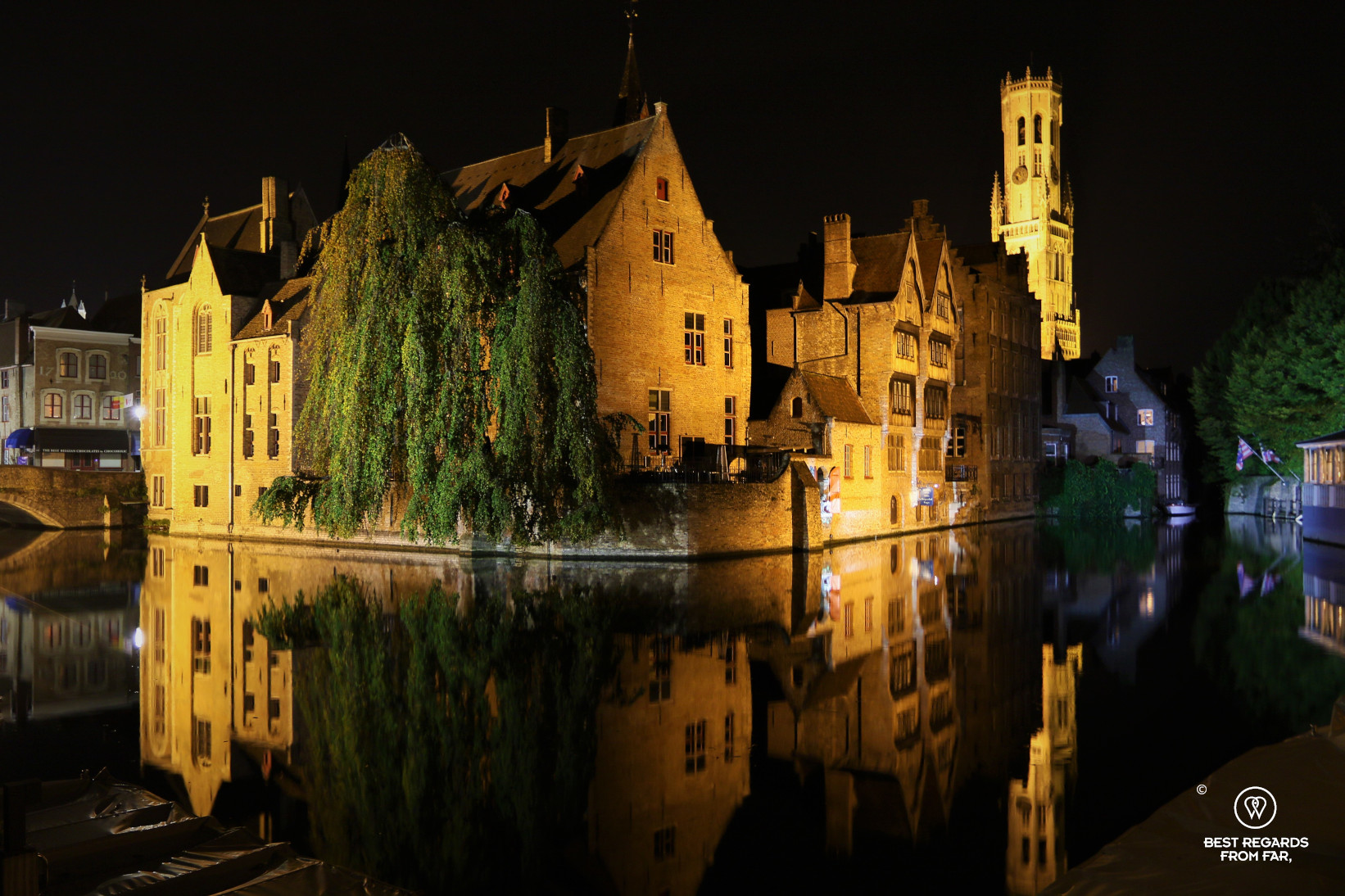 Reflections at the Dijver at night in Bruges, Belgium