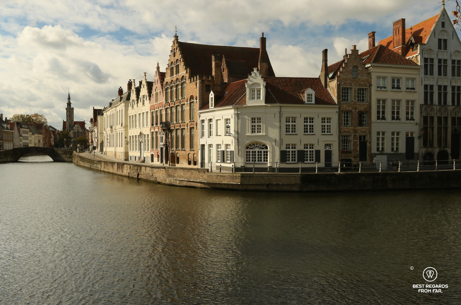 Waterway with cute houses lined up in Bruges, Belgium