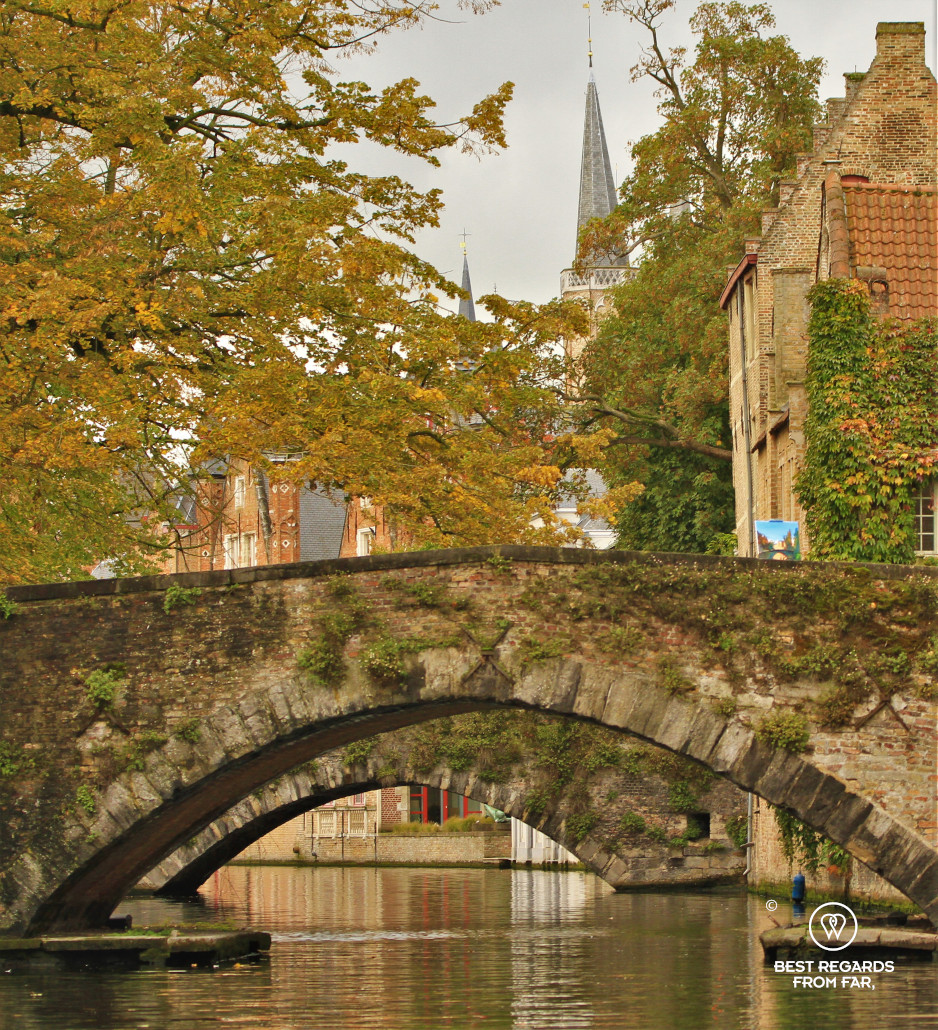 Two bridges over a canal in Bruges in Autumn