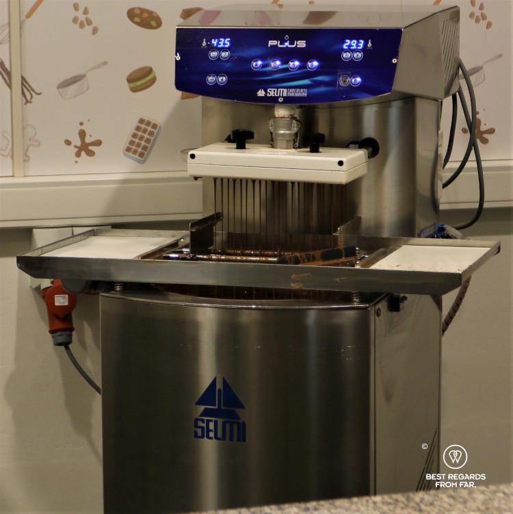 A chocolate machine making chocolates in Belgium