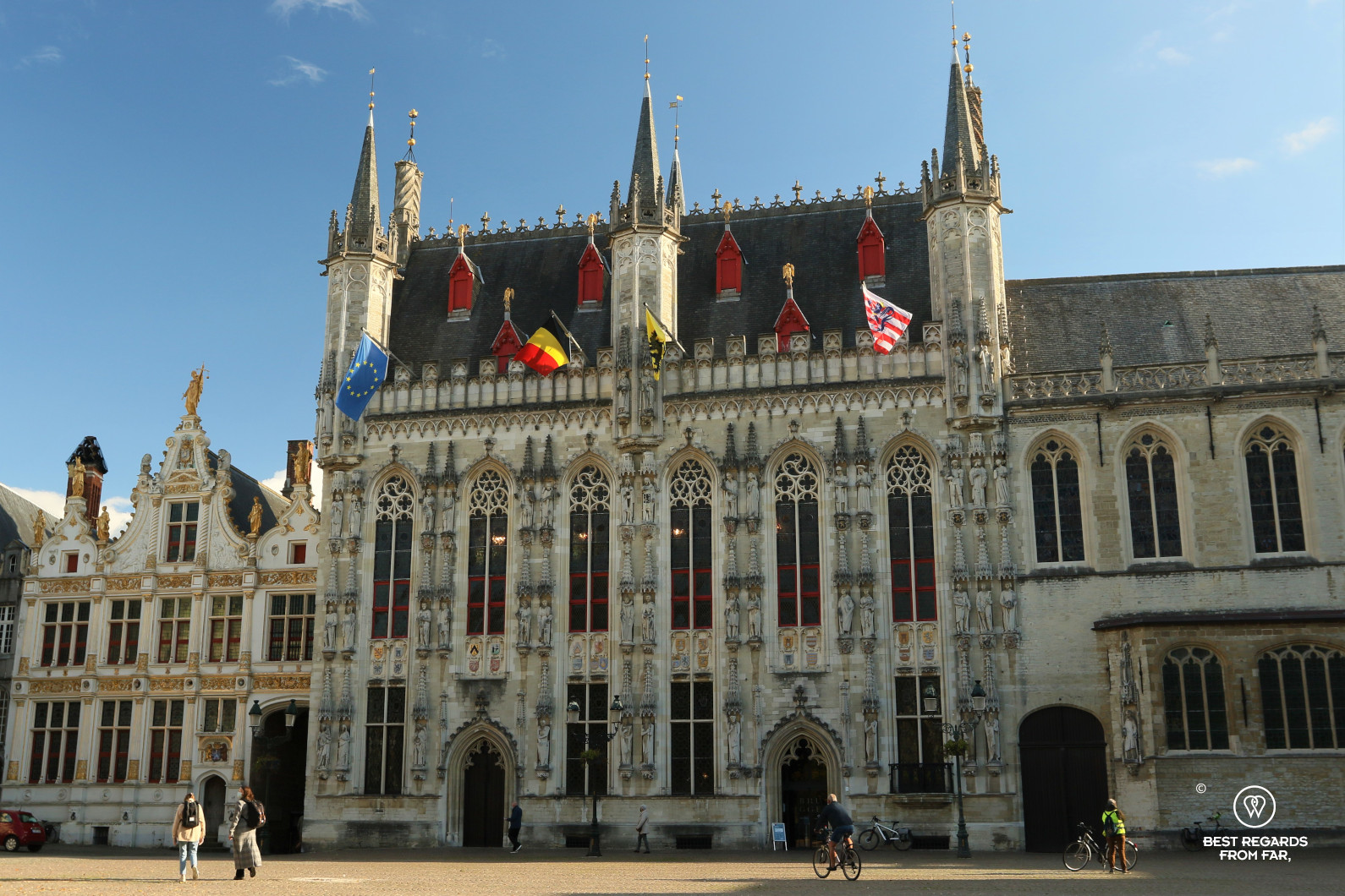 Facade of the gothic city hall of Bruges on a sunny day
