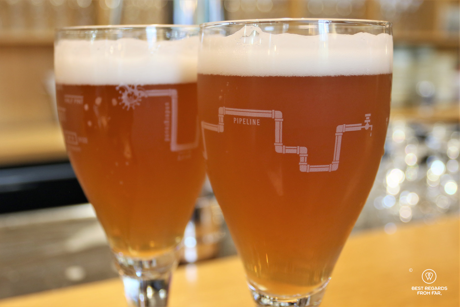 Two glasses of beer with the beer pipeline drawn at the glass