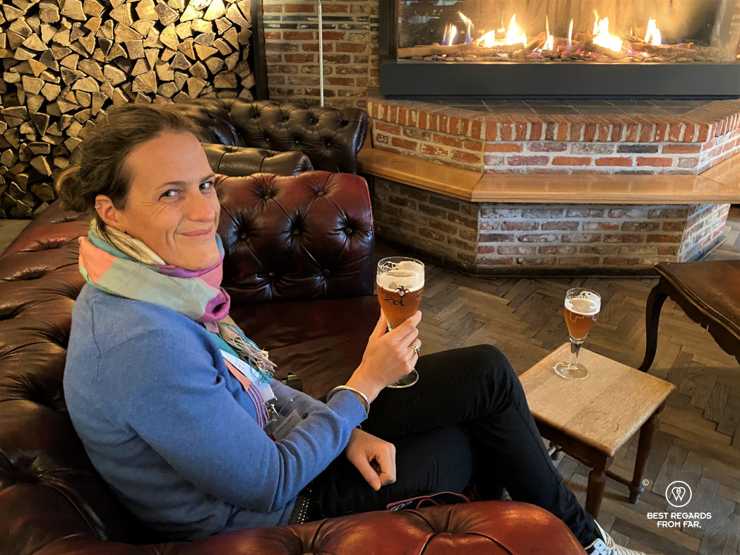 Enjoying a beer by the fireplace at De Halve Maan brewery pub, Bruges.