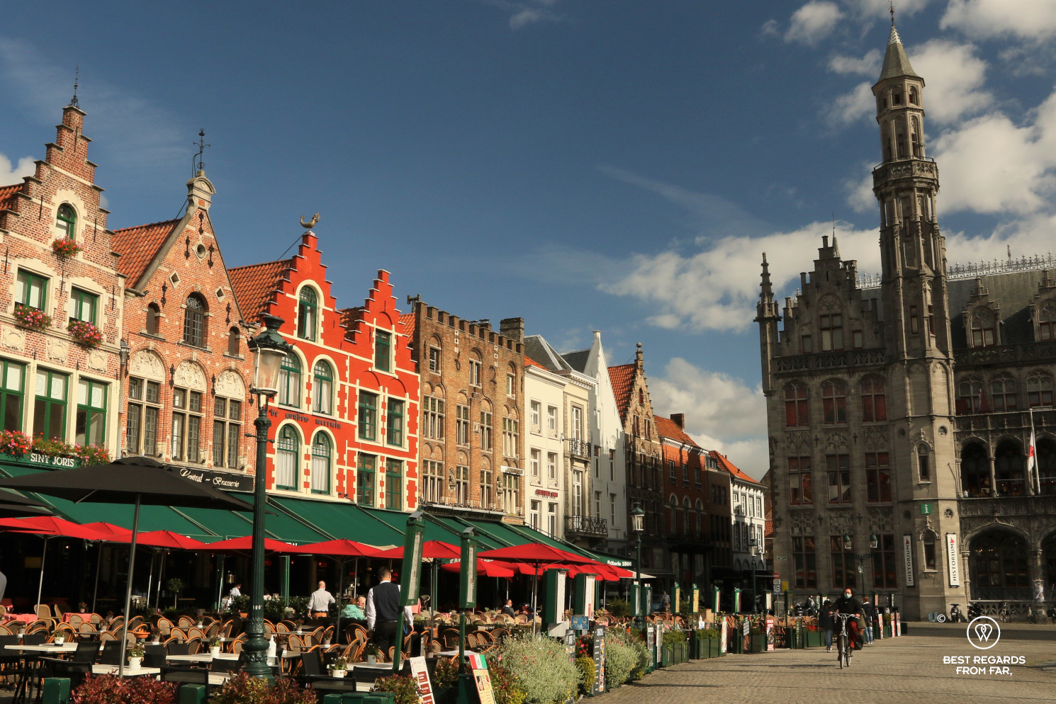 The Market Square of Bruges, Belgium, with its typical medieval architecture.