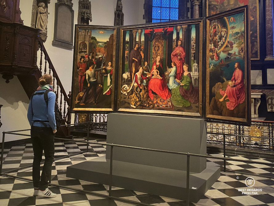 Admiring the Triptych by Hans Memling in the Saint John's Hospital, Bruges, Belgium