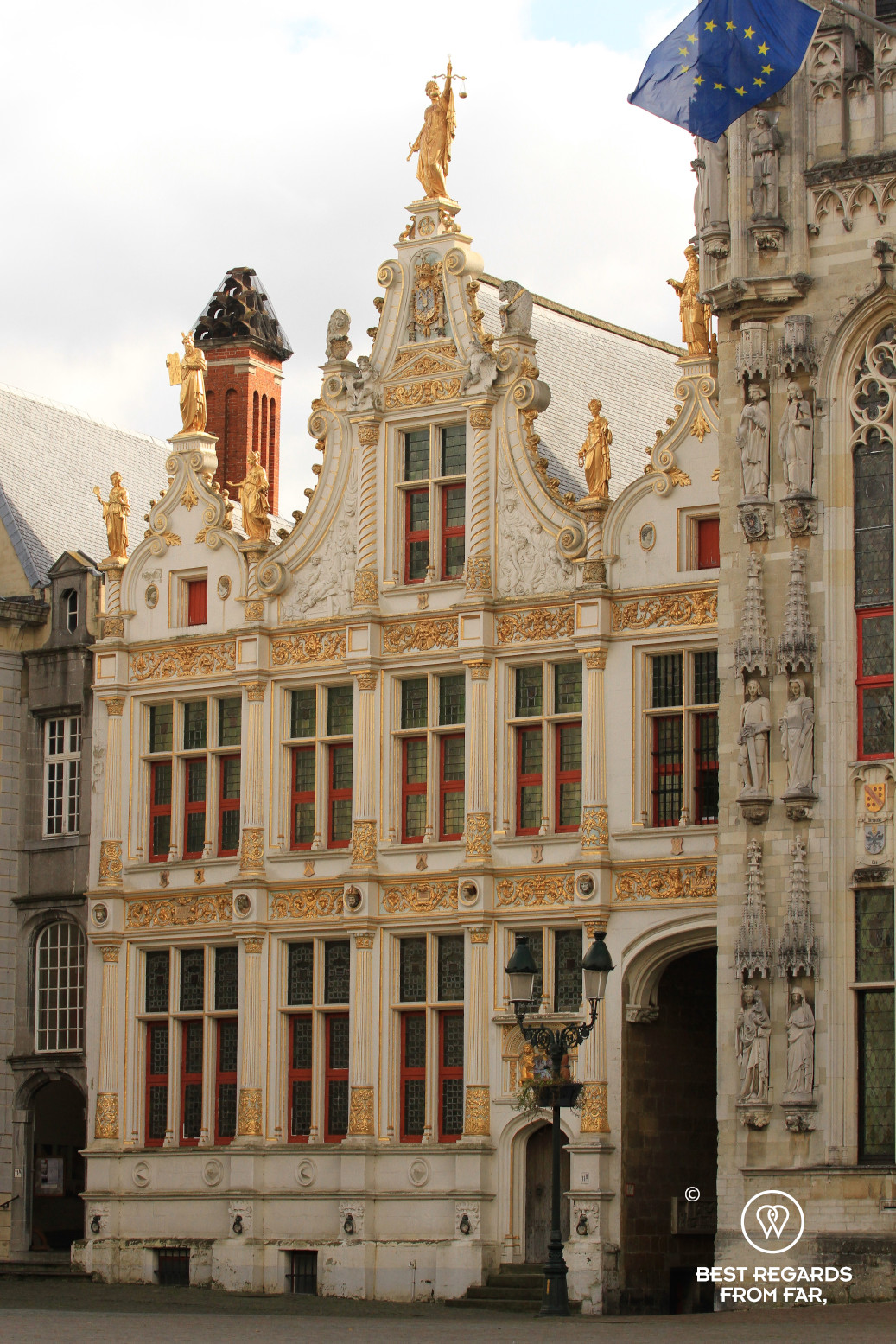 The Liberty of Bruges monument with its white and golden façade, Belgium