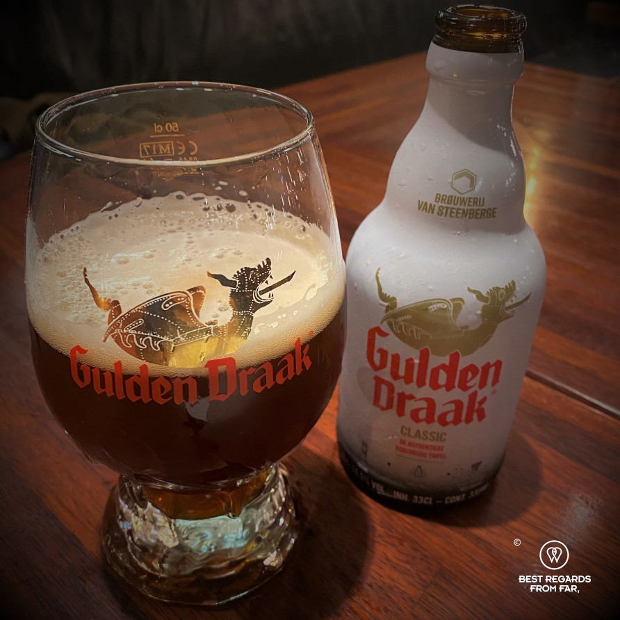 Bottle and glass with Gulden Draak beer from Ghent, Belgium
