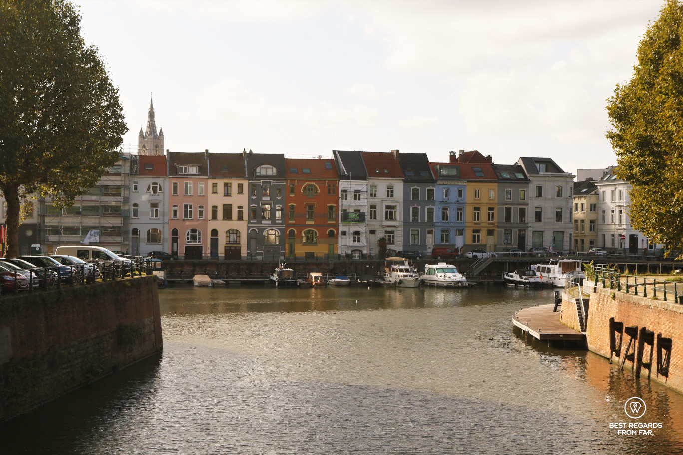Colourful houses along the confluence in Ghent where the first people settled, Belgium
