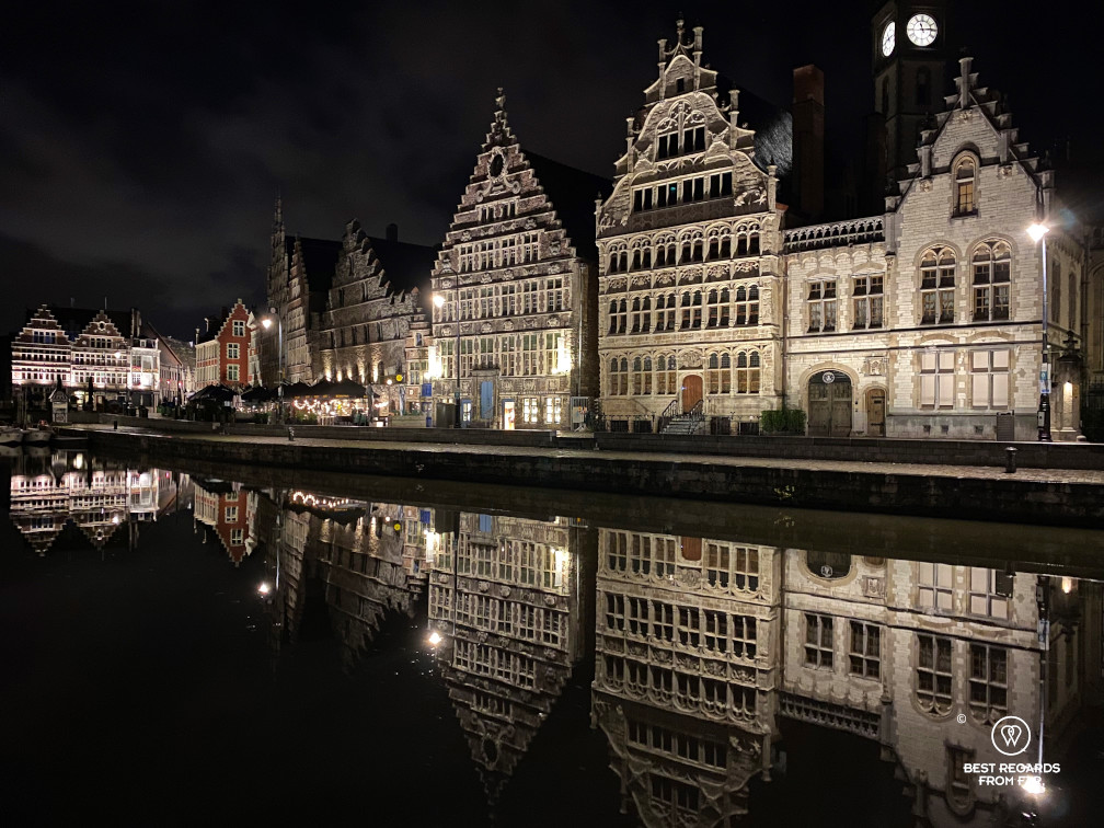 Reflections of medieval buildings in the Lys River along the Graslei in Ghent, Belgium